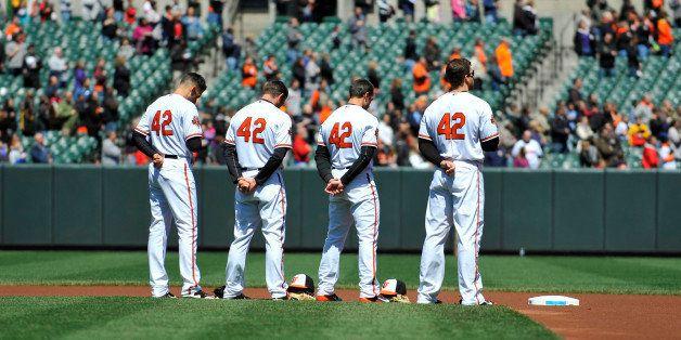 Apr 16, 2014; Baltimore, MD, USA; Baltimore Orioles infielders Ryan Flaherty (left) J.J. Hardy (center left) Steve Lombardozz