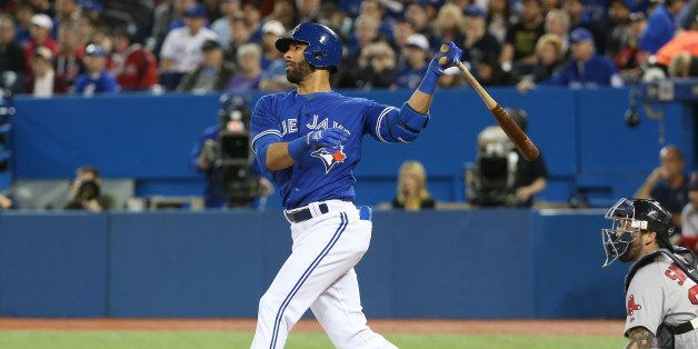 TORONTO, CANADA - APRIL 9: Jose Bautista #19 of the Toronto Blue Jays hits a two-run home run in the first inning during MLB