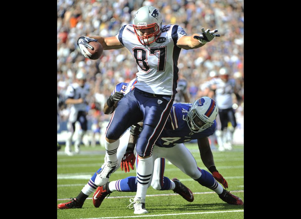 New England Patriots' Rob Gronkowski (87) gets away from Buffalo Bills' Bryan Scott (43) during the second half of an NFL foo