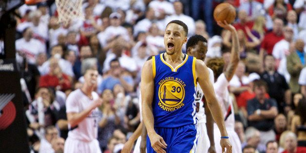 Golden State Warriors guard Stephen Curry reacts after scoring a basket against the Portland Trail Blazers during the second