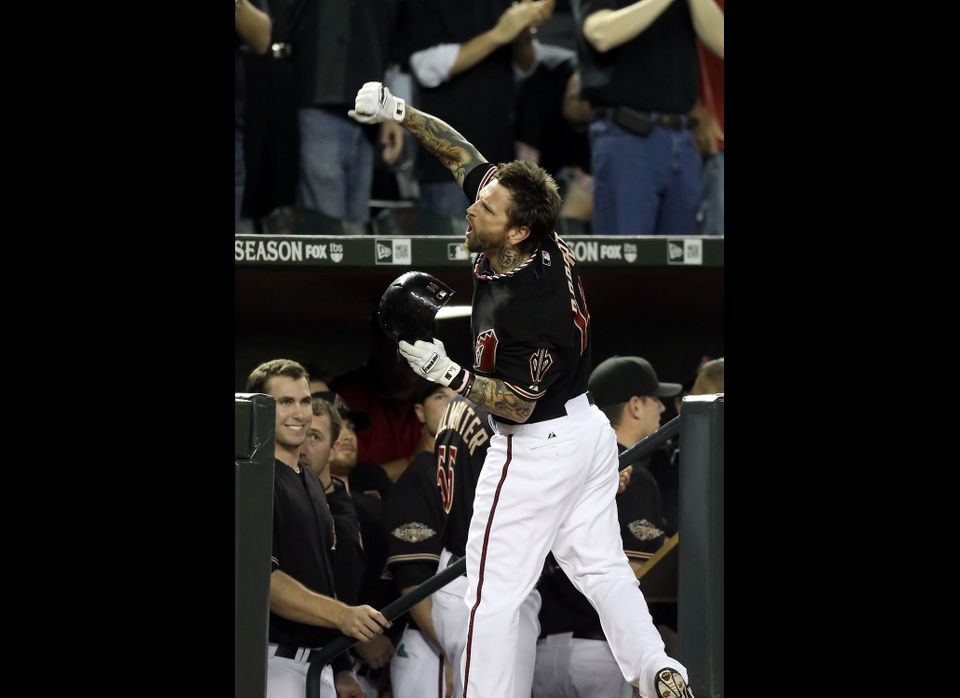 PHOENIX, AZ - OCTOBER 05:  Ryan Roberts #14 of the Arizona Diamondbacks celebrates after hitting a grand slam home run in the