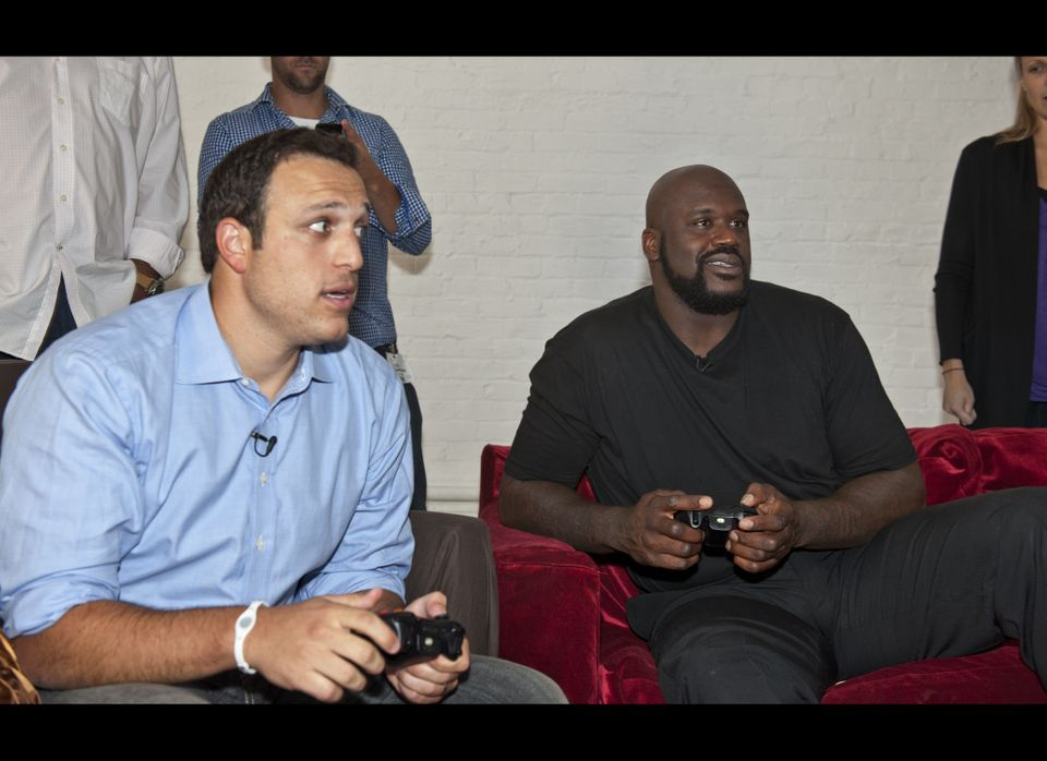 "Shaquille O'Neal plays video games with AOL Huffington Post sports reporter Jordan Schultz to promote the release of ""NBA Jam"