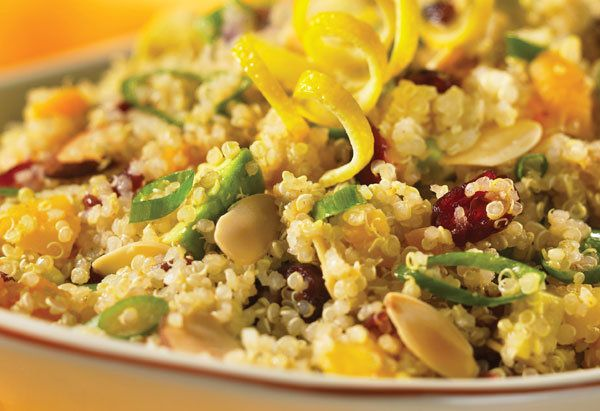 Quinoa, dried cranberries, dried apricots, avocados, green onions and toasted slivered almonds come together to make an ideal