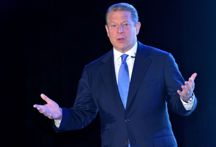 Former US vice president Al Gore gestures as he speaks at an environment lecture about climate change in Manila on June 8, 20