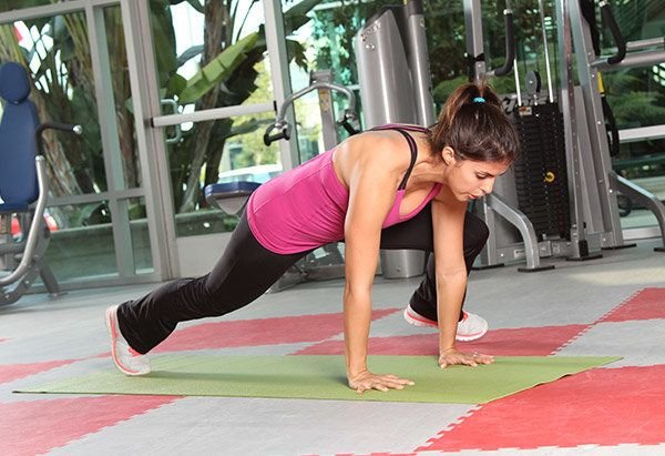 """""""This move really challenges the core without hurting the spine, and also works the hips, glutes and upper body, giving you a"""