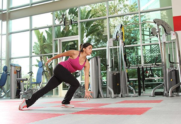 Matthews promises that these Apolo Ohnostyle side lunges will get your heart rate up and work the entire lower body.   1. Sta