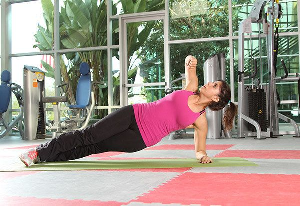 Take the core-strengthening plank up a notch with this move that also involves the obliques and upper back.  1. Lie on your s