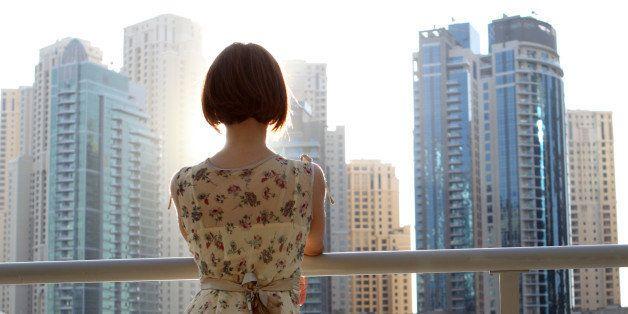 Woman looking at city.