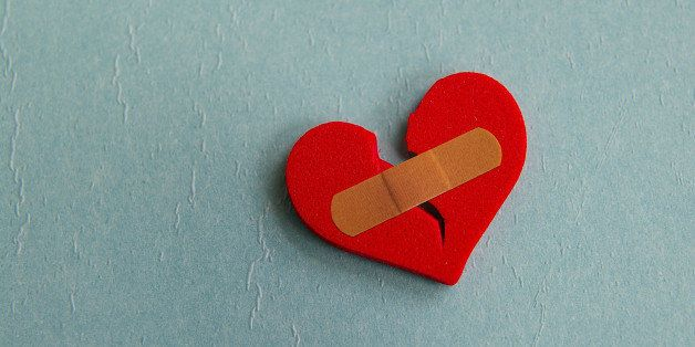 broken heart with a bandage  on ...