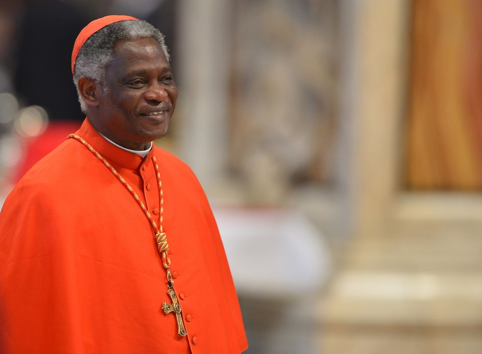 Ghanaian cardinal Peter Kodwo Appiah Turkson attends a mass at the St Peter's basilica on March 12, 2013 at the Vatican. Card