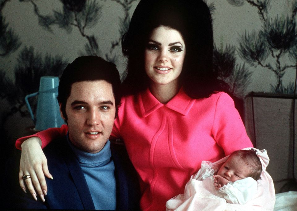 Elvis Presley poses with wife Priscilla and daughter Lisa Marie, in a room at Baptist hospital in Memphis, Tenn., on Feb. 5,