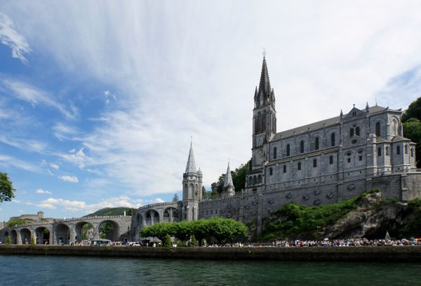 "The <a href=""http://www.lourdes-pilgrimage.com/"" target=""_blank"">southern French town of Lourdes</a> is a popular site where"