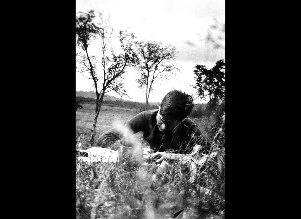 Ernest Hemingway writing while on a Michigan fishing trip in 1916.   Ernest Hemingway Collection. John F. Kennedy Presidentia