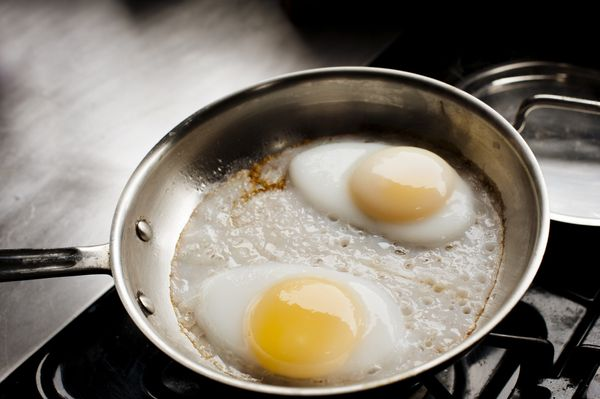 A high-quality stainless-steel fry pan might do a bang-up job with meats and vegetables, but if you try to fry eggs in it, yo