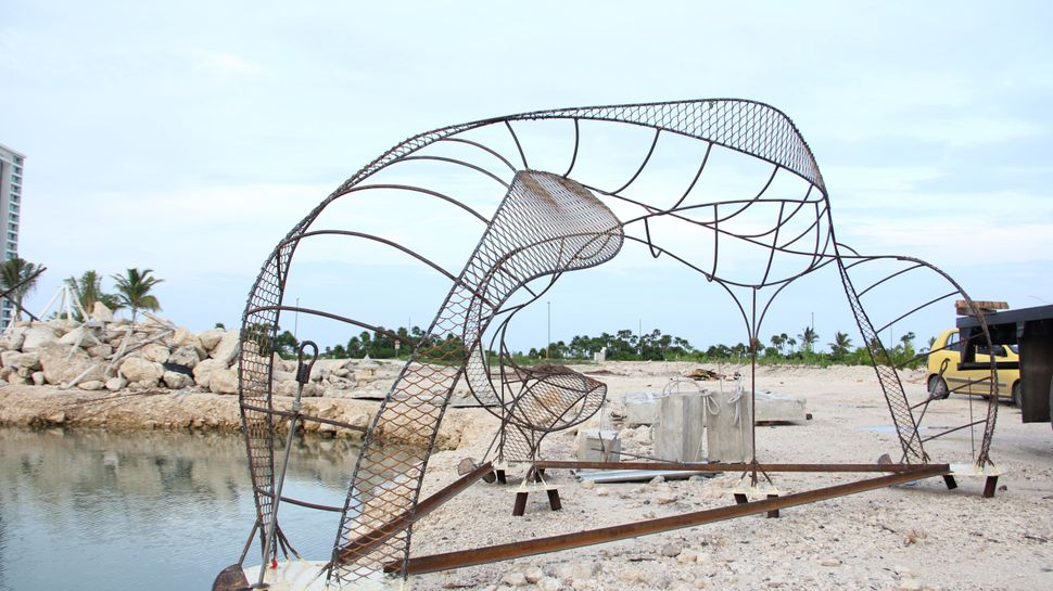 """""""ZOE"""" waits for installation at Puerto Cancun, 2011."""