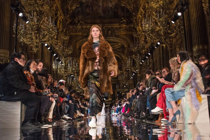 A model wears a faux fur coat on the runway at Stella McCartney's fall/winter 2018 show.