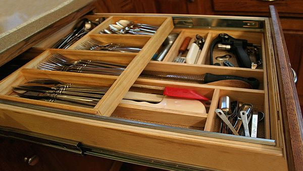 It's a two-for-the-price-of-one storage trick: Take a deep drawer, create a second level that rests above the original, add d