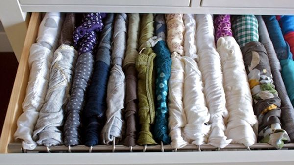 The answer to your stressful (and messy) T-shirt drawer was hiding in your office all this time. Instead of stacking shirts o