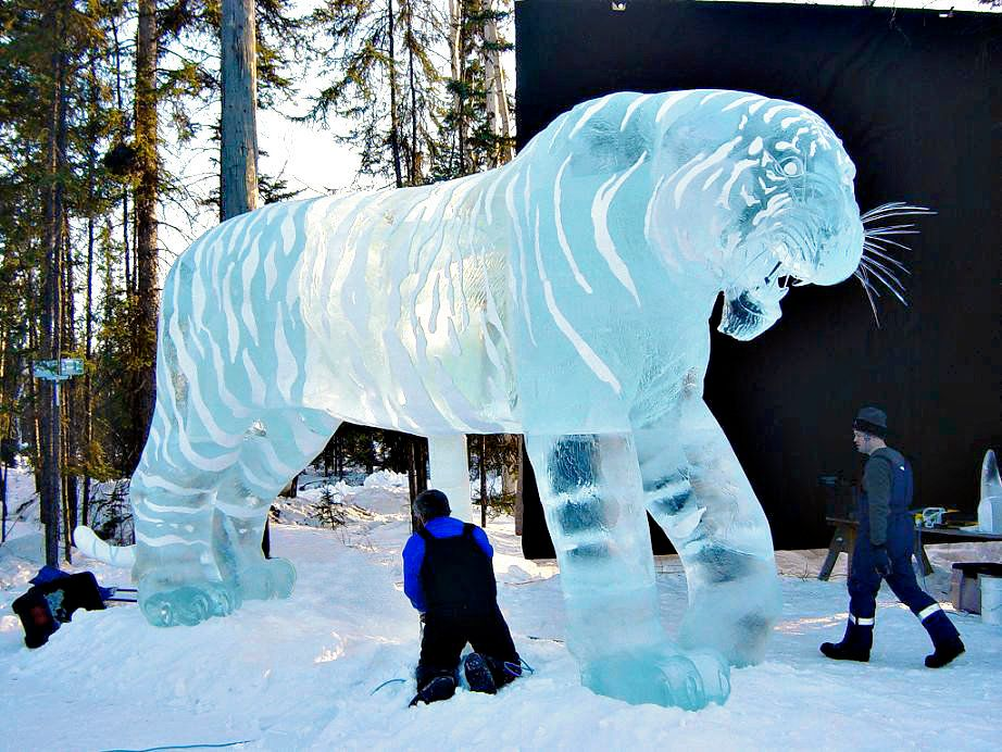 A 12-foot-tall tiger Brice helped carve.