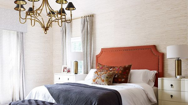 Brass accents are everywhere these days, and marsala's warm tones complement it perfectly. Nate Berkus pairs a headboard the