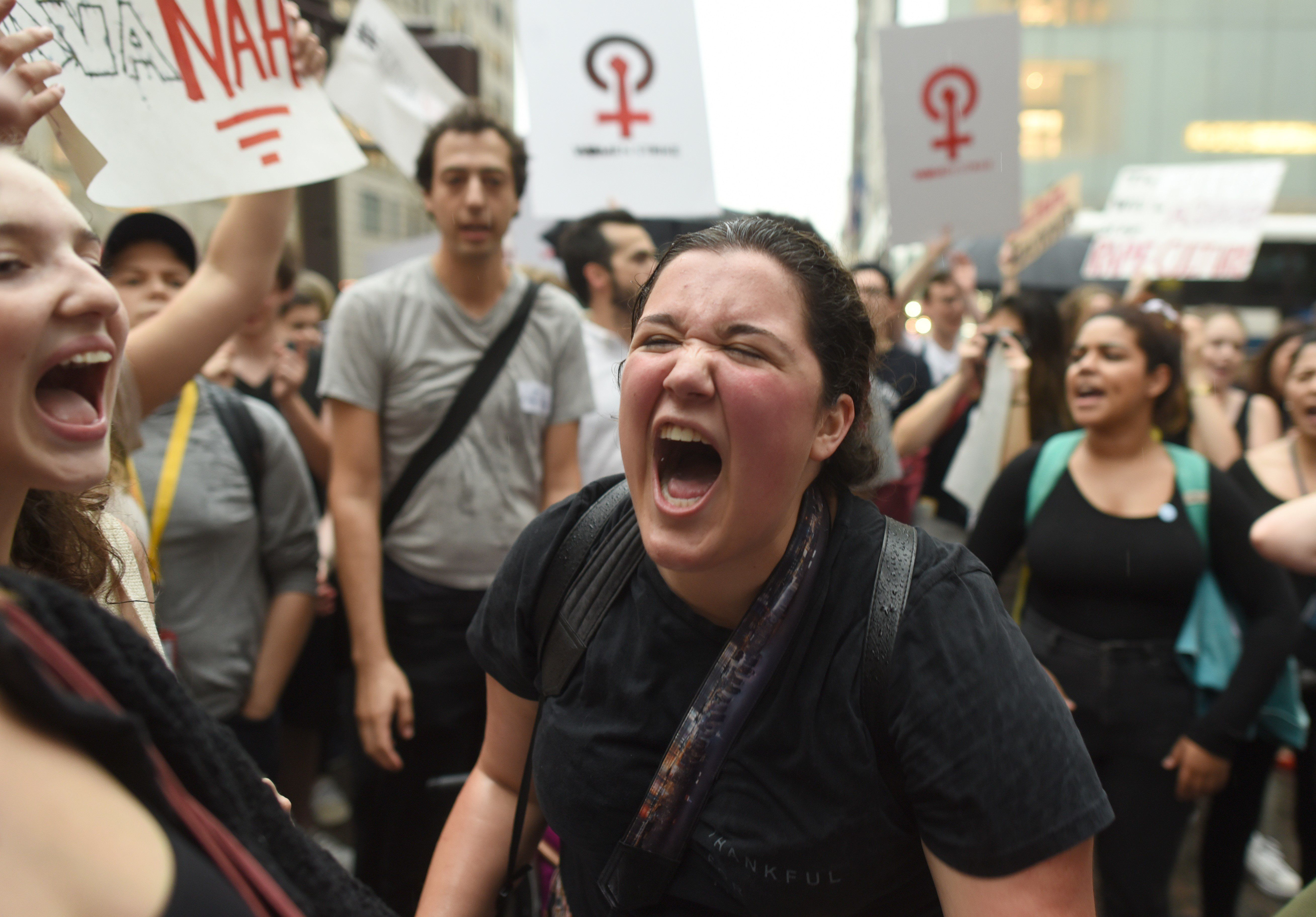 Women hold a  protest in front of Trump Tower in New York on October 4, 2018 against Supreme Court nominee Brett Kavanaugh. - Top Republicans voiced confidence Thursday that Brett Kavanaugh will be confirmed to the US Supreme Court this weekend, as they asserted that an FBI probe had found nothing to support sex assault allegations against Donald Trump's nominee.'Judge Kavanaugh should be confirmed on Saturday,' Senator Chuck Grassley of Iowa, the chairman of the Senate Judiciary Committee, told reporters. (Photo by TIMOTHY A. CLARY / AFP)        (Photo credit should read TIMOTHY A. CLARY/AFP/Getty Images)