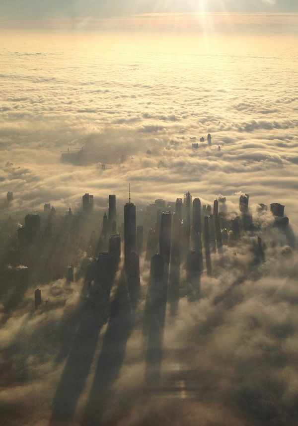 """Buildings in New York City seen above the clouds.  Photo: <a href=""""http://www.redbubble.com/people/amtraver/works/11396377-ne"""