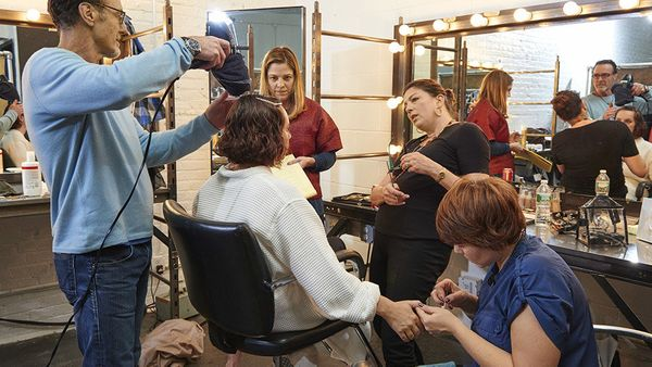 <br>Annie gets a manicure while Patrick dries her hair and Susan checks out her makeup.