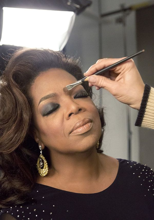 "Rutledge plays up Oprah's brows. (To try this look, use Lancôme Sourcils Tint Eyebrow Pen, $26; <a href=""http://www.sephora.c"