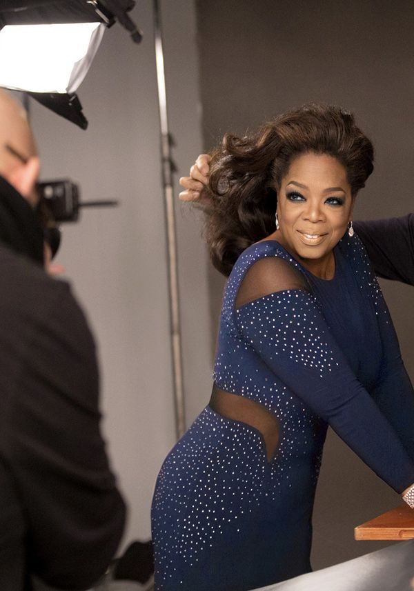 Walker perfects Oprah's hair while photographer Ruven Afanador gets his shots.