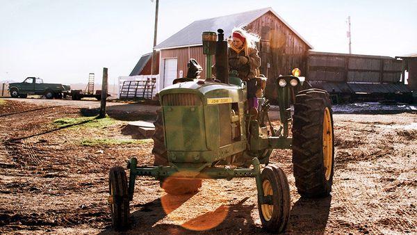 Kellie Gregorich preps for morning chores on her family's farm in La Motte, Iowa.