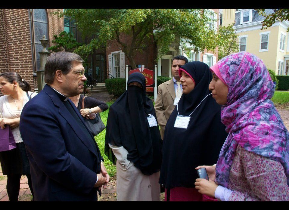 Canon John Peterson of the National Cathedral converses with guests from Egypt.