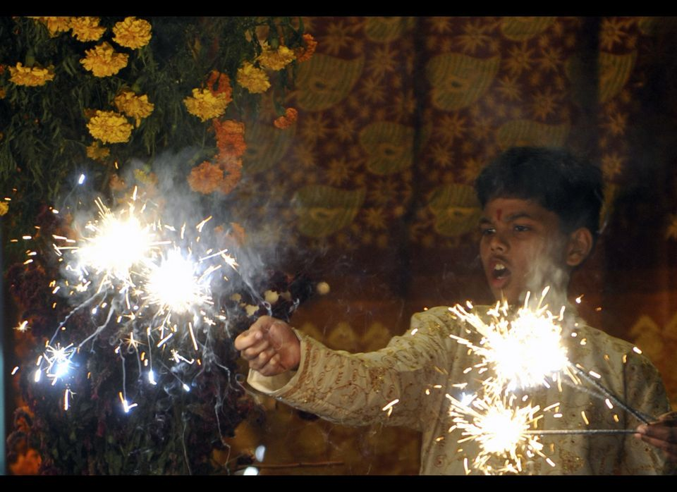 In this photo, an Indian boy plays with fireworks during Diwali in Hyderabad on November 5, 2010 (Noah Seelam / AFP / Getty I