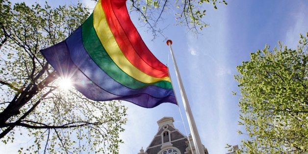 Rainbow flag flies in the mast at Homomonument in front of the Wester Church in Amsterdam,Netherlands.