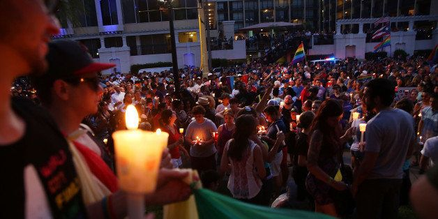 ORLANDO, FL - JUNE 19: People attend a memorial service on June 19, 2016 in Orlando, Florida. Thousands of people are expecte