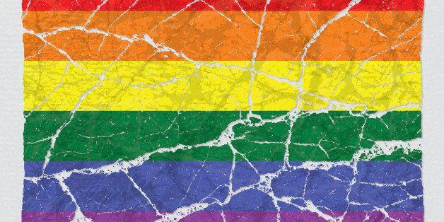 Cracked broken grunge textured lgbt rainbow gay pride flag.