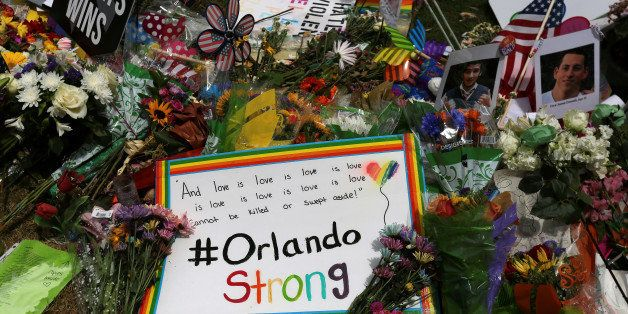 An #OrlandoStrong sign is left at a makeshift memorial for the victims of the Pulse night club shooting in Orlando, Florida,