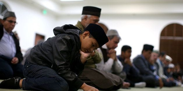 CHINO, CA - DECEMBER 03:  A Muslim boy prays in the mosque during a prayer vigil at Baitul Hameed Mosque on December 3, 2015