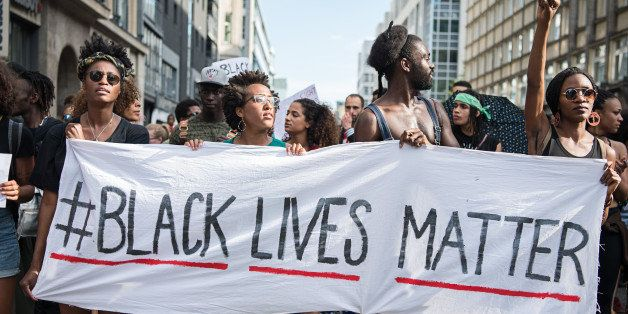Protestors hold a banner reading 'Black Lives Matter' during a demonstration in Berlin, on July 10, 2016 with the motto 'Blac