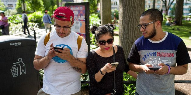 NEW YORK, NY - JULY 11: A group of friends play Pokemon Go on their smartphones at Union Square, July 11, 2016 in New York Ci