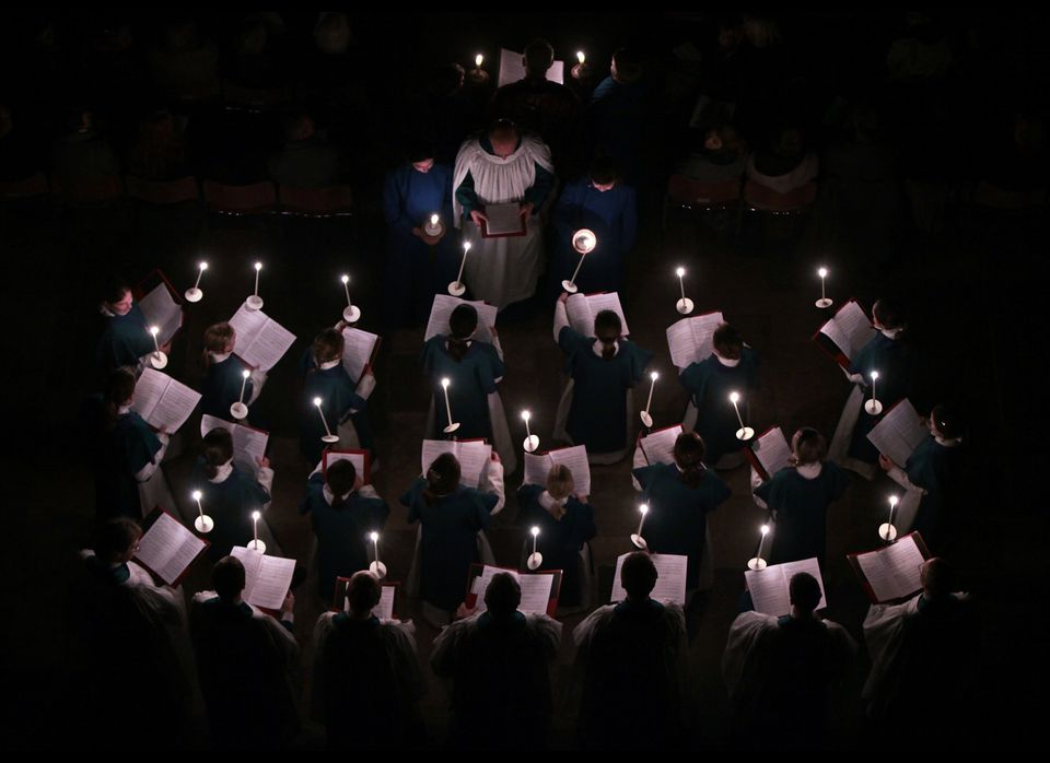 SALISBURY, ENGLAND - NOVEMBER 28: The interior of Salisbury Cathedral is illuminated by candles carried by choristers during