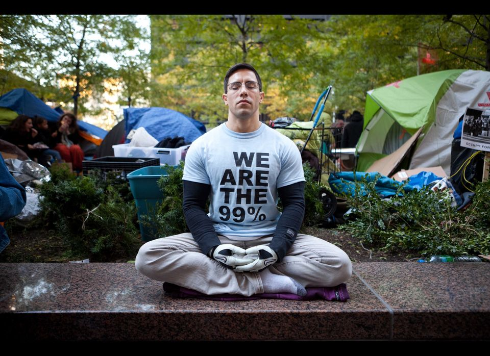 Angel Soto, 32, of Staten Island, meditates at the Occupy Wall Street protests in Zuccotti Park, Sunday, Nov. 6 in New York.