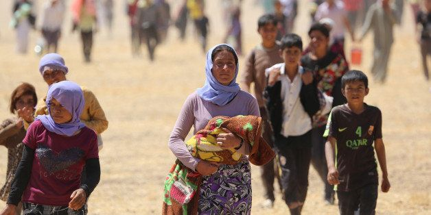 MOSUL, IRAQ - AUGUST 9:  Thousands of Yezidis trapped in the Sinjar mountains as they tried to escape from Islamic State (IS)