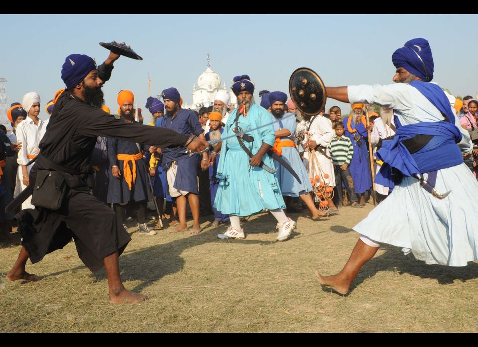 Members of the traditional Sikh religious warriors' Nihang Army perform a Sikh martial art, known as Gatka, on the occasion o