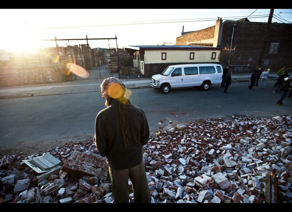 Shane Claiborne stands among the rubble of Camden.  The School of Conversion visitors take part in a 'Reality Tour' of Camden