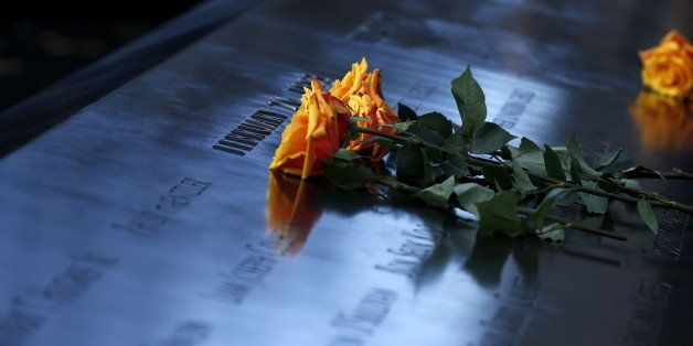 Flowers are seen on the reflecting pool of the 911 Memorial during a commemoration ceremony marking the 23rd anniversary of t