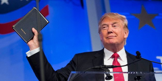Donald Trump, president and chief executive of Trump Organization Inc. and 2016 Republican presidential candidate, holds up a