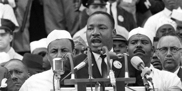 In this Aug. 28, 1963 photo, The Rev. Dr. Martin Luther King Jr., head of the Southern Christian Leadership Conference, gestu