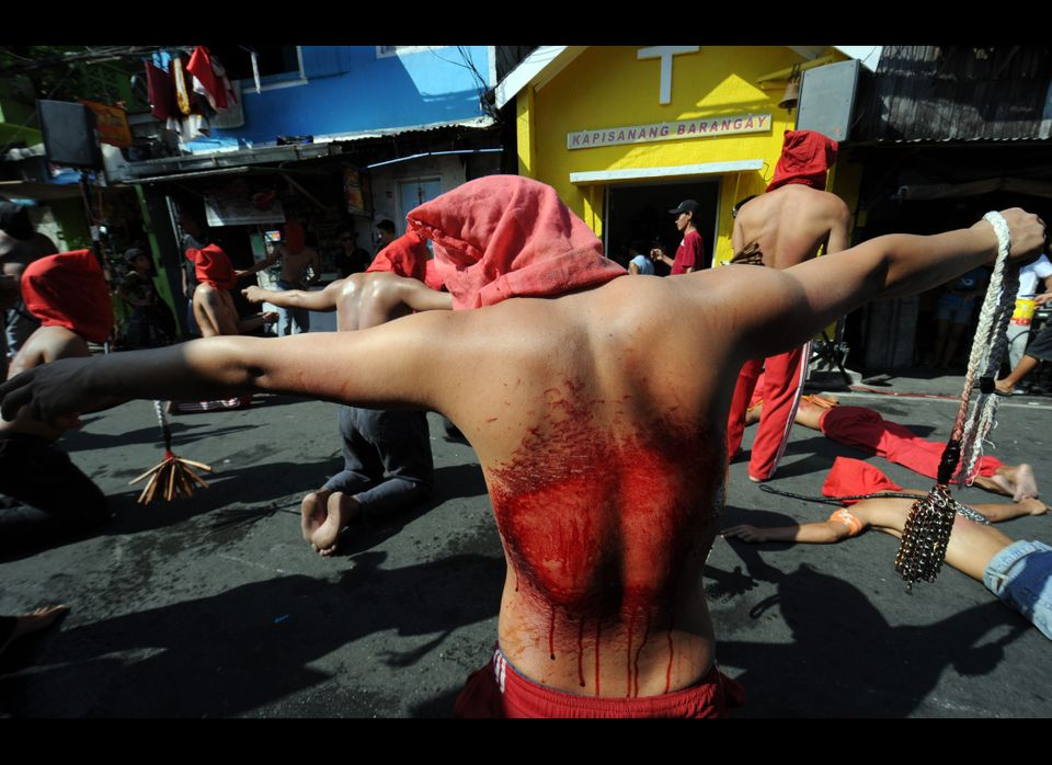 Penitents flagellate themselves as part of Lenten observance in Manila on April 5, 2012. The dominant Roman Catholic church f