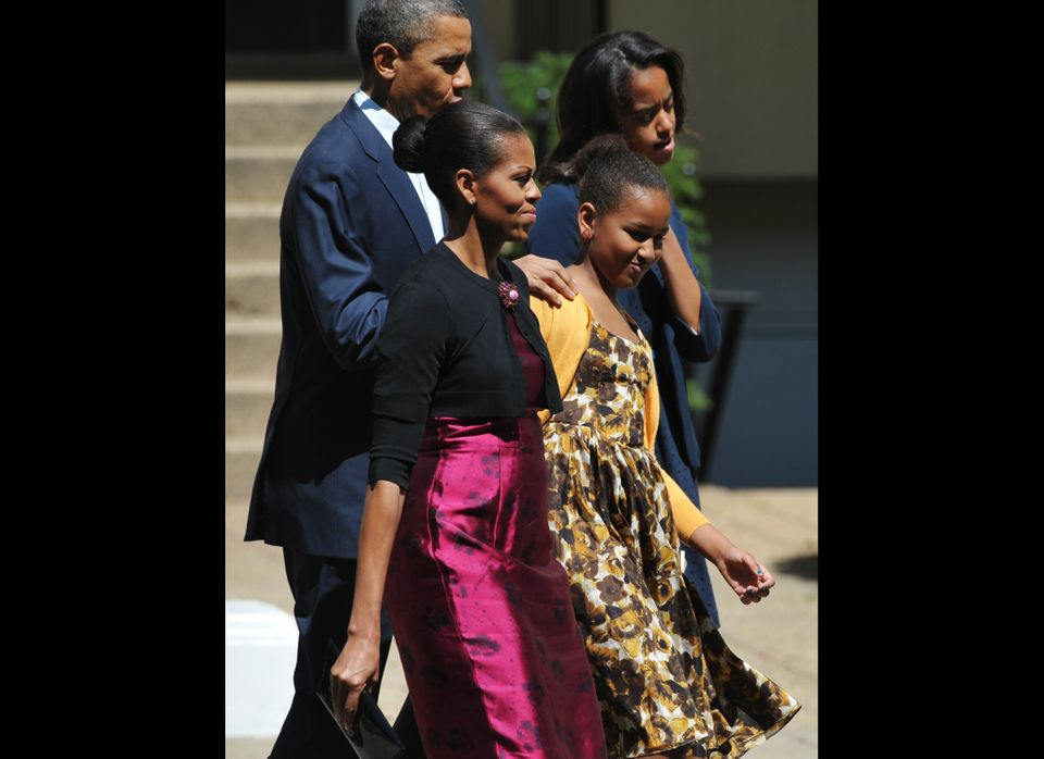 US President Barack Obama, First Lady Michelle Obama and daughters Sasha (2nd R) and Malia (R) walk from St John's Episcopal