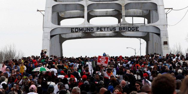 SELMA, AL - MARCH 8: Marchers retrace the steps of those who marched with Dr. Martin Luther King, Jr. 50 years ago over the E